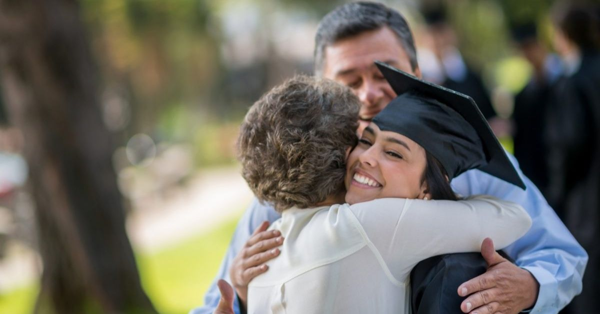 Graduation Gowns and Hat Hug the Parent in Congratulation